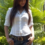 Actress Riya Sen giving damn hot sexy pose in her white shirt