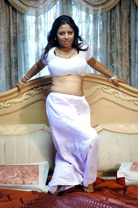 spicy-actress-Sunakshi-white-dress-navel