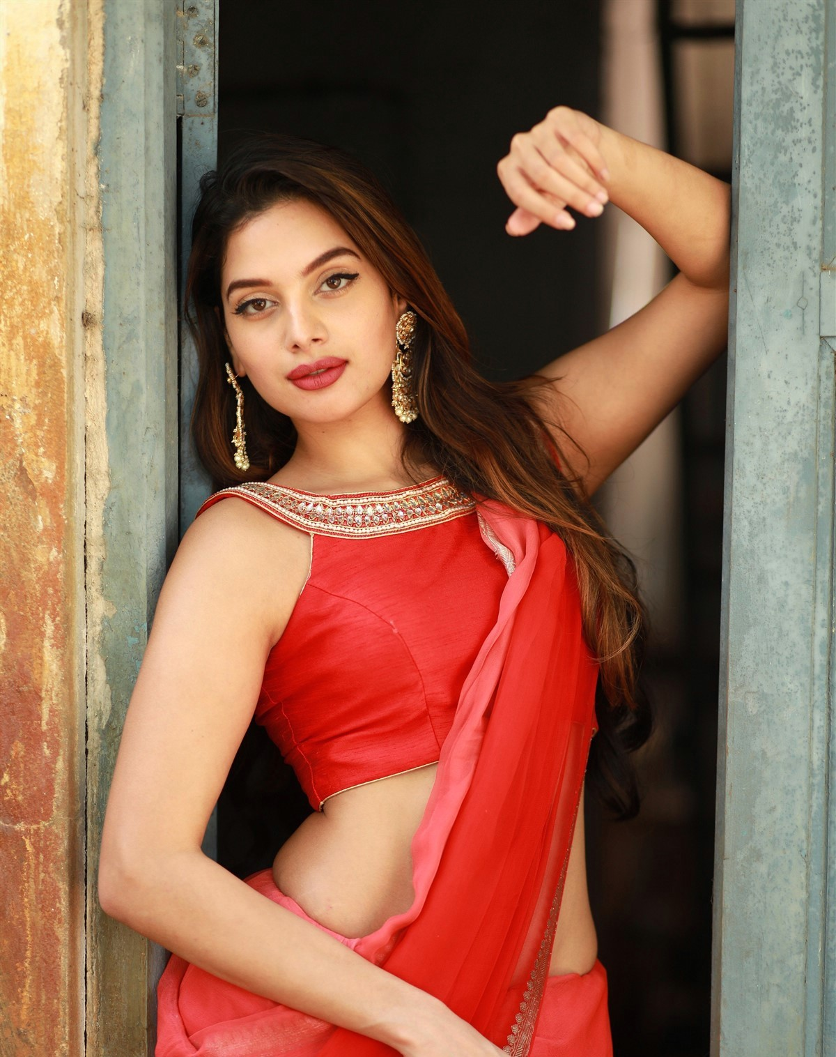 actress-tanya-hope-red-saree-hot-and-sexy-pose-3
